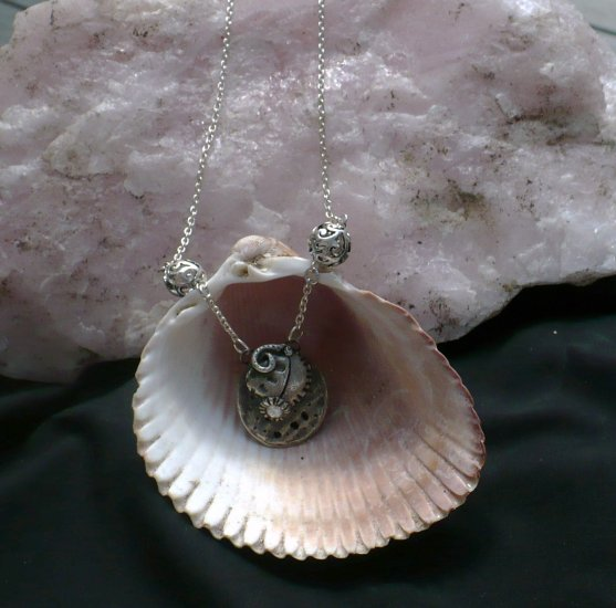.999% Fine silver shell with CZ