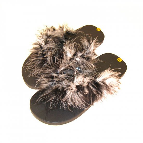 Black and white feathered flip-flops.
