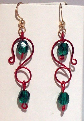 red S with green stones