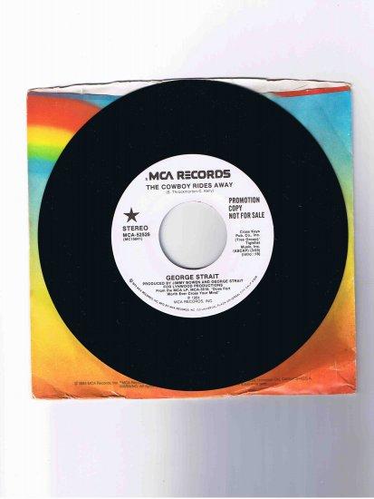 "George Strait 45 rpm single, ""The Cowboy Rides Away"" (1984)"
