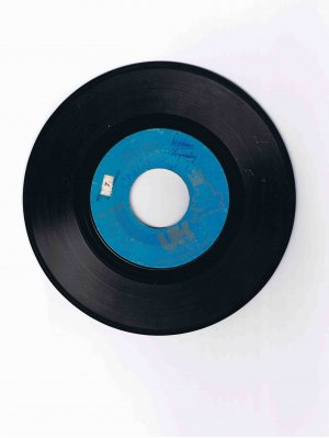 "First Class (John Carter) 45rpm single, ""Beach Baby"" / ""Both Sides of the Story"" (UK Records)"