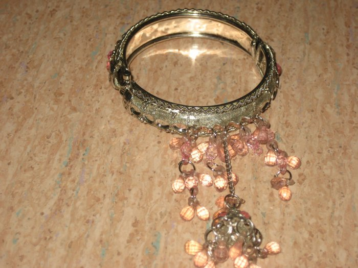 silver bracelet with pink beeds