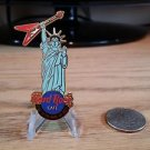 Hard Rock Cafe New York Statue of Liberty holding red flying V Guitar Pin