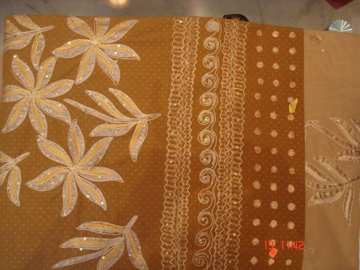 T-369: Light Brown Salwar Kameez with floral design and thread work
