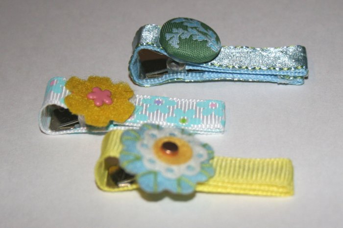 Set of three blue and yellow vintage alligator clips