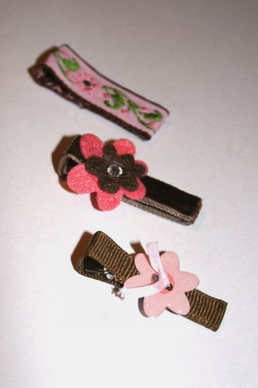 Set of three pink and brown alligator clips