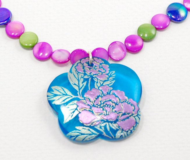 Floran handpainted resin pendant with mother of pearl beads finished off with a toggle clasp.