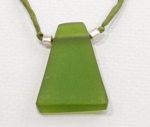 Green resin pendant on green silk cord
