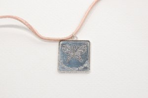 Butterfly Charm on Pink Suede