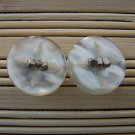 pearly white with silver stud earrings