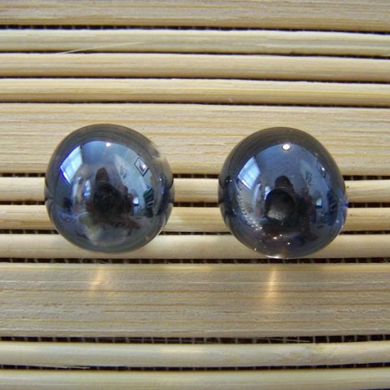 glass with black stud earrings