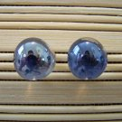 glass with navy stud earrings