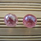 glass with pink stud earrings