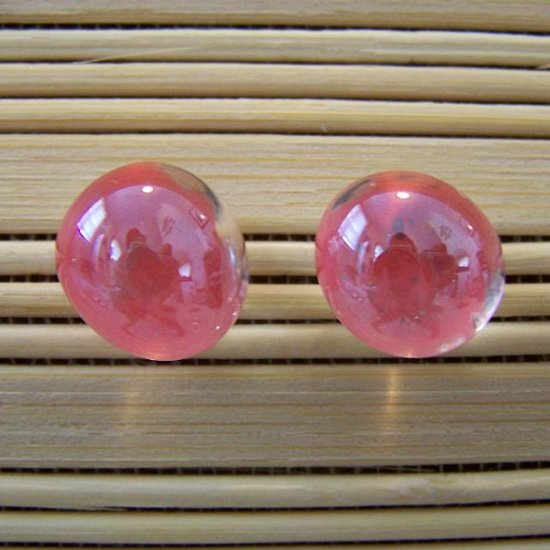 glass with coral stud earrings