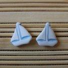 white sailboat stud earrings