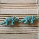 green triceratops stud earrings