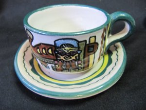 Vintage F.C.A. Peru Handpainted Inca Animal and Mask Design Green Rim Cup and Saucer