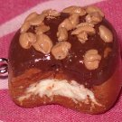 Chocolate frosted donut clay charm with yummy crumbles