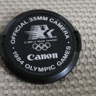 CANON AUTH 52mm 1984 OLYMPIC GAMES LENS CAP AE-1 H196
