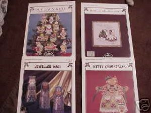 A 4-Pak Assortment of Cross Stitch Patterns ~i