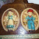 Vintage Chalkware Dutch Boy and Girl Wall Plaques