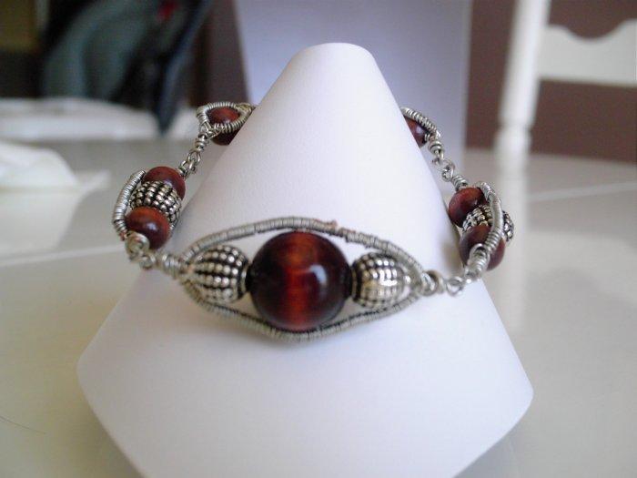 Dark wood and base metal wire bracelet