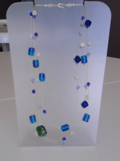 Illusion necklace made of blue glass beads.