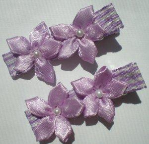 Checkered purple/white Ribbon w/ 2 five petal purple flowers Clippies