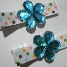 Multi colored Polkadots Ribbon with Blue Flower shaped Rhinestone Clippies