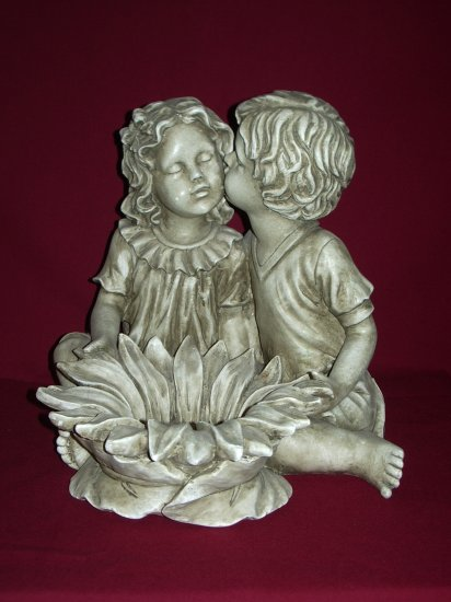 Boy and Girl With Flower Statue