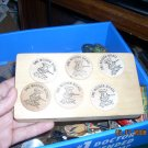 7 wooden nickels art master denver