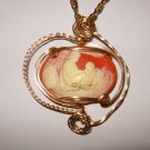 14 K rolled gold wire wrapped resin cameo w/24 inch gold chain