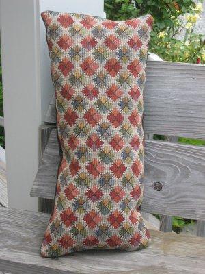 Multi coloured geometric pillow