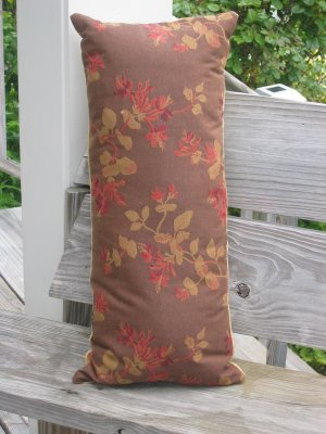 Brown, red, gold flower pillow