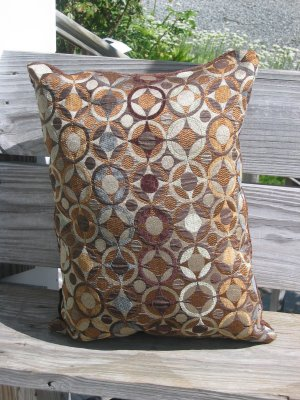 brown, blue and bronze pillow