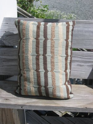 pale blue, beige and brown pillow