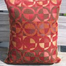 Red and mustard circle pillow