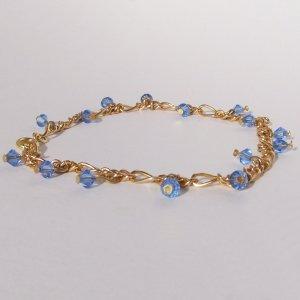 Glimmering gold bracelet or anklet