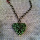 Green, metal heart locket bracelet $24.99 #131B395G