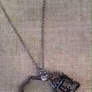 silver metal framed glass window locket with carousel charm $29.99 #J011AS