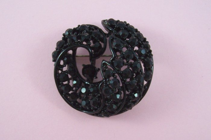Vintage Black Rhinestone Brooch Domed Swirling Design