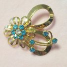Vintage Aqua Blue Rhinestone Flower and Bow Brooch Tiered Gold Tone Color