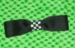 Super cute black and checkerboard bow