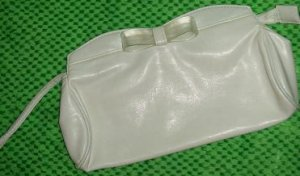 Cute white mini purse with zipper and magnet closure