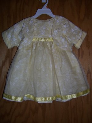 Yellow and white floweres party dress size 6-9 mos.