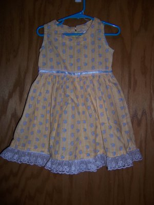 Yellow party dress with whit lace trim. Size 2