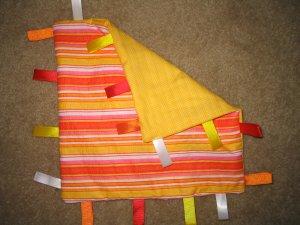 Orange taggies for baby - crib toy
