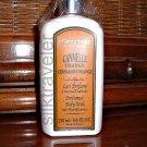 L'occitane perfumed Body Milk Cannelle Orange  8.4 oz.  Cinnamon with Almond extract silky veil
