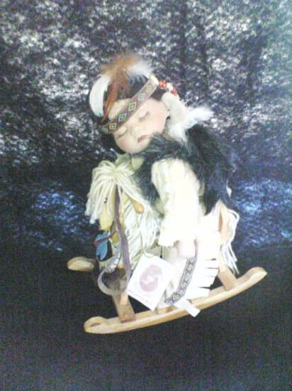 rocking horse indian doll