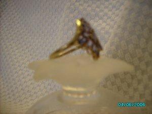 Ladies 10 KT gold tanzanite cluster ring
